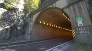 Stock Video Footage of transport trucks entering tunnel wide shot