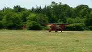 Red biplane takeoff Stock Footage