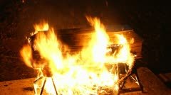 Coffin on fire 02 Stock Footage
