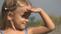 Little Girl Shading her Eyes, Child Looking into the Distance, Child's View Stock Footage
