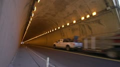 Transport truck flat lumber exiting tunnel wide shot, the whole tunnel Stock Footage