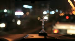 In Africa, Nigeria a car is driving through the night with a burning cross - stock footage