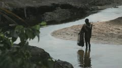In Africa, Nigeria a fisherman throws his net into the water Stock Footage
