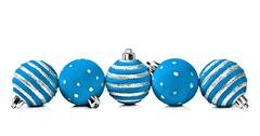 five christmas decoration ball on a white background with space for text - stock photo