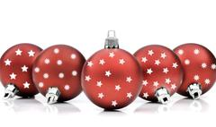 Red christmas ornaments on white - stock photo