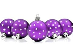 Purpe christmas ornaments on white - stock photo