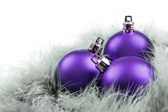 Purpe christmas ornaments on white Stock Photos