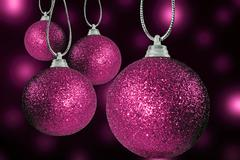 close up of colorful christmas baulble ballsin different sizes  hanging on st - stock photo