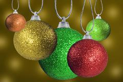 Close up of colorful christmas baulble ballsin different sizes  hanging on st Stock Photos