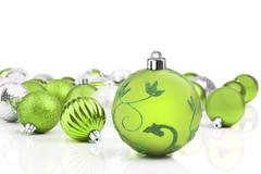 green christmas ornament baubles with white background - stock photo
