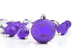 purple decorative christmas ornaments with white background - stock photo
