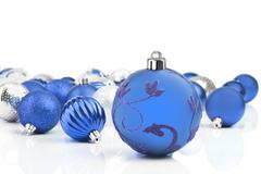 Blue decorative christmas ornaments with white background Stock Photos
