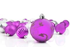 pink decorative christmas ornaments with white background - stock photo