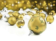 Golden decorative christmas ornaments with star background Stock Photos