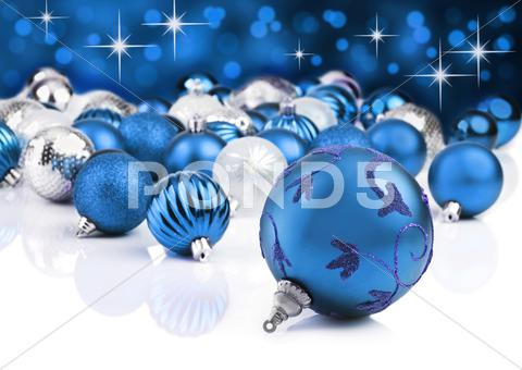 Stock photo of blue decorative christmas ornaments with star background