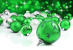 green christmas ornament baubles with star background - stock photo