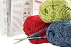 yarn needles pattern and knitting on white - stock photo