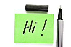 Small memo note with black pen - saying hi Stock Photos