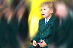 day of knowledge. surprised first grade boy. - stock photo