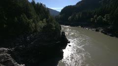 Fraser River in autumn, medium shot, backlit Stock Footage