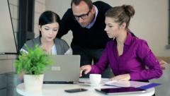 Two businesswomen working on laptop and asking boss for help Stock Footage