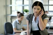 Young businesswoman talking on mobilephone in the office Stock Footage
