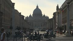 Pedestrian and car traffic in Rome.Basillica Sf.Petre - stock footage