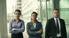 Serious business people walking and looking to camera, steadicam shot HD Stock Footage