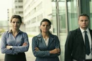 Serious business people walking and looking to camera, steadicam shot NTSC Stock Footage