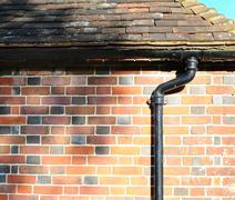 drain pipe, tiles and bricks - stock photo