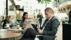 Businessman working on tablet computer in cafe, steadicam shot HD Stock Footage