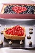 heart-shaped tart with redcurrants - stock photo