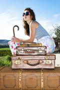 Young woman traveling with her suitcases Stock Photos