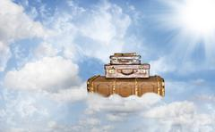 Three old leather suitcases on a heavenly journey Stock Photos