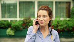 Businesswoman walking and talking on cellphone in the city, steadicam shot HD Stock Footage