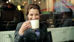 businesswoman gets coffee drink smile sit cafe steady M HD - stock footage