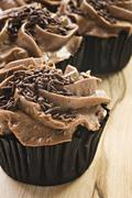 Lovely fresh chocolate cupcakes - very shallow depth of field Stock Photos