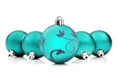 Stock Photo of blue christmas baubles on white background with space for text