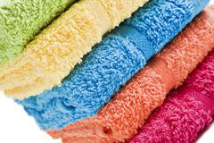 Colorful towels on a white background with space for text Stock Photos