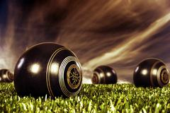 Stock Photo of close up of  bowling balls on an open bowling field at sunset