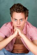 young man with chequered shirt - stock photo