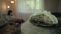 Fat woman eating cake Stock Footage