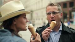 Happy couple eating ice cream in the city, steadicam shot HD - stock footage