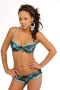 Brunette beauty in blue lingerie Stock Photos