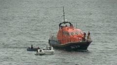 Life boat practicing a rescue. - stock footage