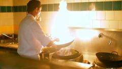 Chef prepares a meal in the fire Stock Footage