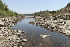 Rocky riverbank Stock Photos