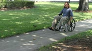 Stock Video Footage of Paraplegic Veteran Wheelchair