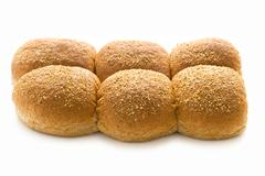 wholewheat bread rolls isolated on white - stock photo
