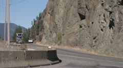 Transport truck coming down steep hill in canyon Stock Footage